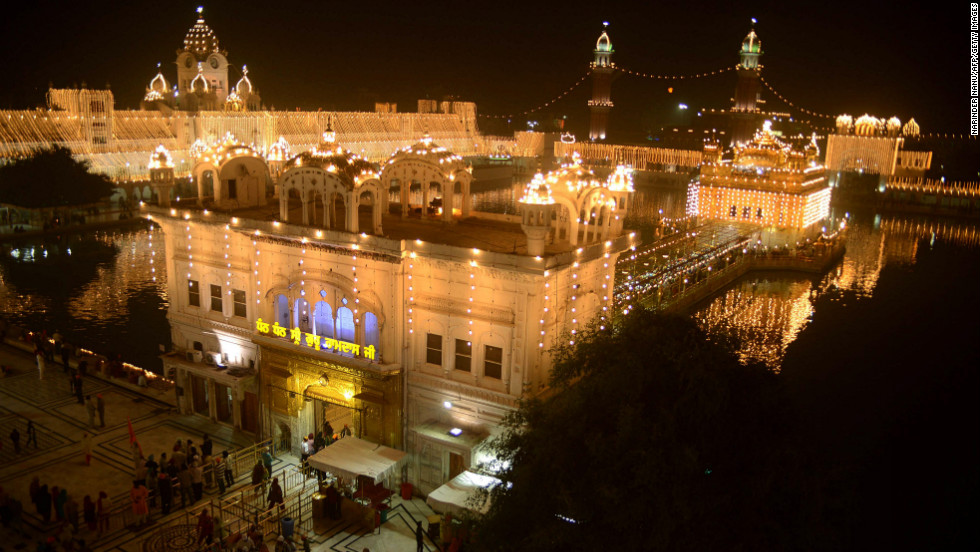 Devotees pray at the Sikhism's holiest shrine, the Golden Temple in Amritsar, India, on Monday, November 12, the eve of Bandi Chhor Divas, or the third day of Diwali.