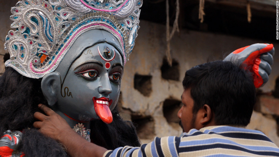 "An artist puts the final touches on a statue of Hindu goddess Kali ahead of Diwali, the Festival of Lights, in Allahabad, India, on Saturday, November 10. <a href=""http://cnnphotos.blogs.cnn.com/2012/10/15/sculpting-gods-from-clay/"" target=""_blank""><strong>See one photographer's perspective on the making of Hindu gods on CNN Photos.</a></strong>"