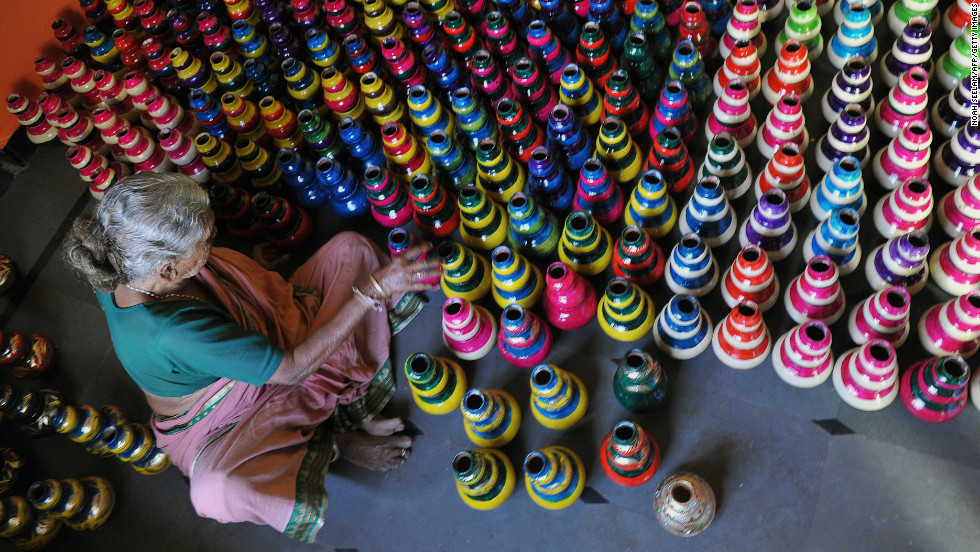 An artisan arranges diyas, or painted earthenware oil pots, ahead of Diwali in Hyderabad, India, on Tuesday, November 6. Diyas are lit and placed around the home during the Festival of Lights.