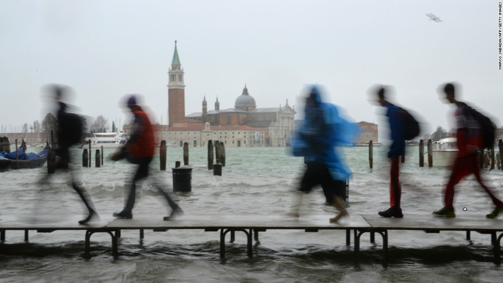 Heavy rain and high winds combined with seasonal high tides have caused floods in parts of northern Italy.