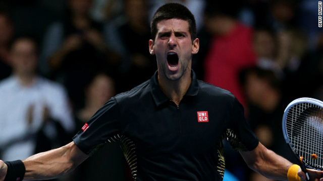 Novak Djokovic celebrates as he closes out his ATP World Tour Finals match with Roger Federer to take the title.