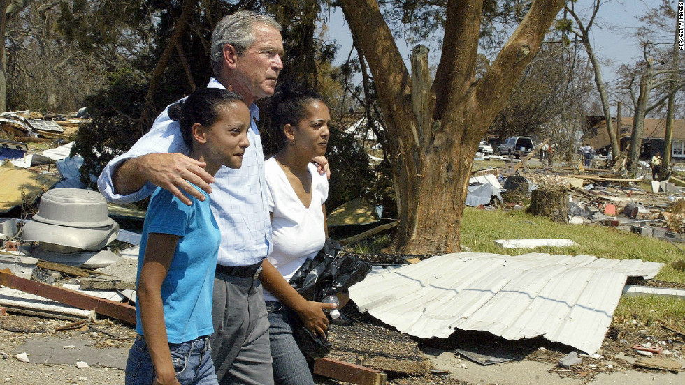 President George W. Bush's delayed response to Hurricane Katrina is considered by many to be his administration's greatest failure. Here, he tours the damage done by the storm as he consoles two sisters in Biloxi, Mississippi. (September 2, 2005)