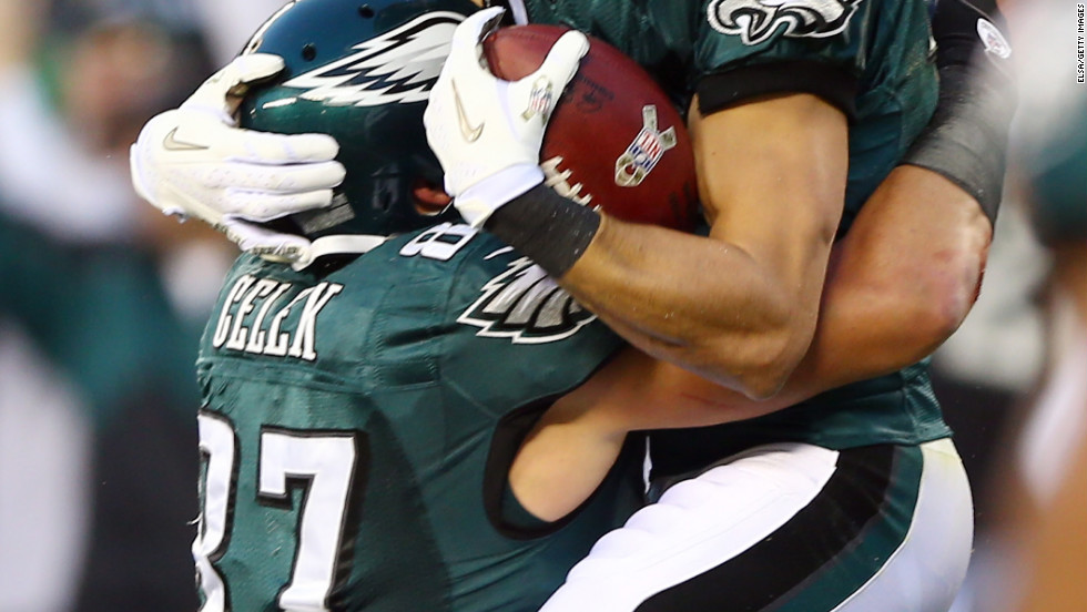 Riley Cooper of the Eagles celebrates his touchdown with teammate Brent Celek in the first quarter against the Cowboys on Sunday.