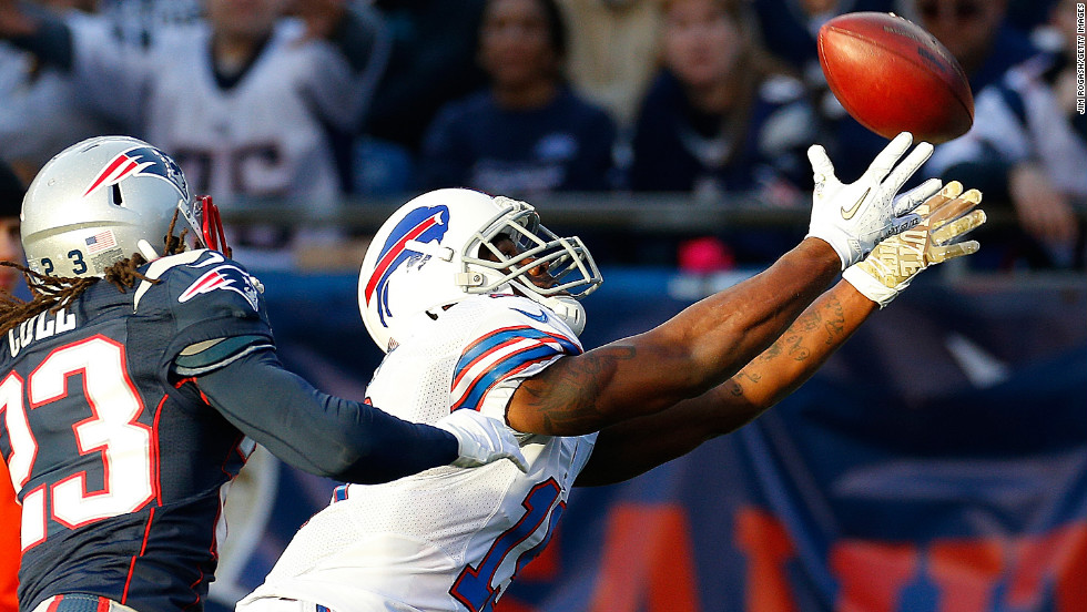 Donald Jones of the Buffalo Bills comes up short on a pass as Marquice Cole of the Patriots defends in the second half of Sunday's game.