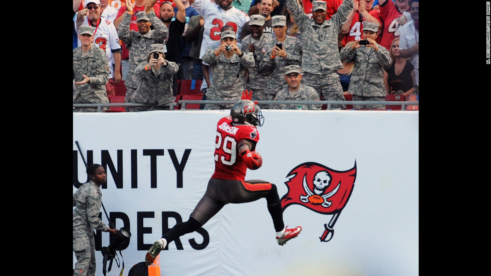 Tampa Bay cornerback Leonard Johnson runs 83 yards with a pass interception for a touchdown against the San Diego Chargers on Sunday.