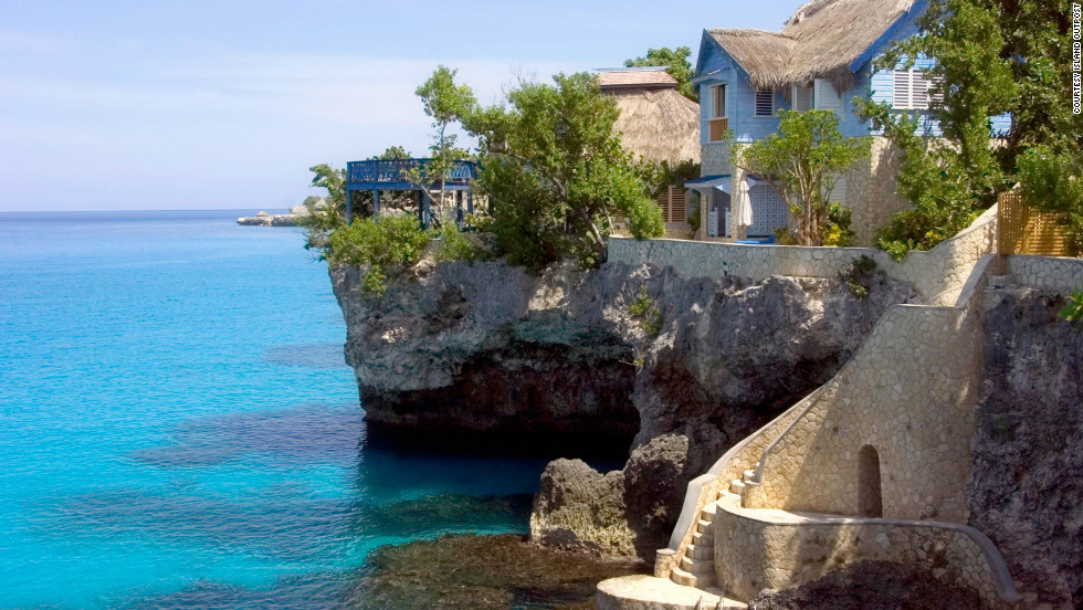 The 12 villas at The Caves are built into the rock shelf with expansive views over the impossibly blue Caribbean Sea.
