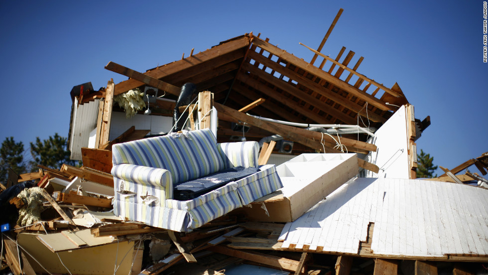 Debris strewen by Superstorm Sandy sits piled outside a damaged home in Mantoloking, New Jersey, on Monday.
