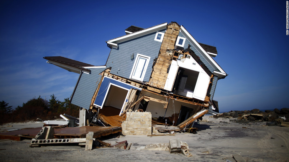 "A home that was destroyed by Hurricane Sandy sits in ruin in Mantoloking, New Jersey, on November 12, 2012. There were 11 disaster events in 2012, each one causing more than $1 billion in damages, the <a href=""http://www.ncdc.noaa.gov/news/ncdc-releases-2012-billion-dollar-weather-and-climate-disasters-information"" target=""_blank"">National Climatic Data Center</a> said. Sandy's costs are estimated to be the highest at about $65 billion in losses, the center said."