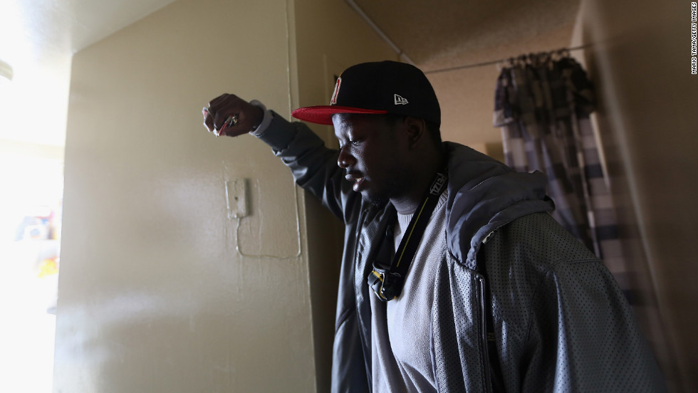 Dale Freeman stands in his water-damaged apartment in a public housing building that still doesn't have power on Monday in Brooklyn. About 58,000 customers in the Rockaways, Long Island and Brooklyn require more extensive repairs before electricity can be restored.