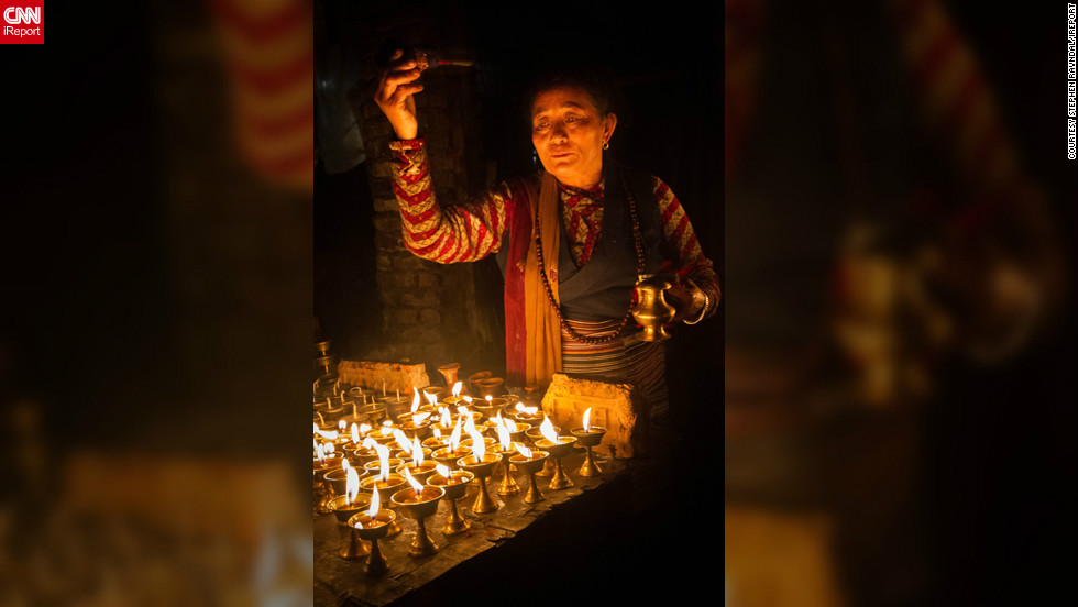 "<a href=""http://ireport.cnn.com/people/TravelinRav"">Stephen Ravndal</a> of Boston, Massachusetts, took this photo of a woman lighting a candle to mark the beginning of Diwali whilst wandering the backstreets of Boudnath, Nepal. ""The woman's attention to detail and devotion are plainly obvious and the lights, which are such an integral part of the festival, really capture a warm and serene mood,"" he says."