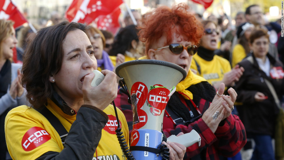 Protesters shout during a demonstration at Cibeles Square in Madrid.