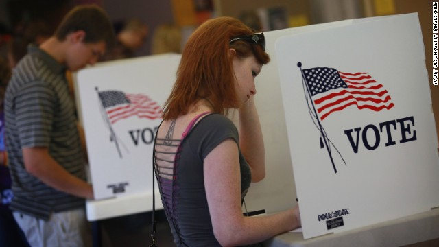 Student Courtney Johnson (R) votes on the campus of the University of Northern Iowa on September 28, 2012.