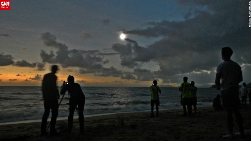 "iReporter <a href=""http://ireport.cnn.com/docs/DOC-881111"">David Brungger</a> was one of many people to witness the eclipse at Palm Cove in the north of Queensland. ""When everything finally went almost totally dark, some people were clapping, some people were cheering with joy, and we all took our eclipse glasses off to enjoy some of the most exciting and beautiful seconds of my life. Too bad it only lasted roughly one minute,"" he says."