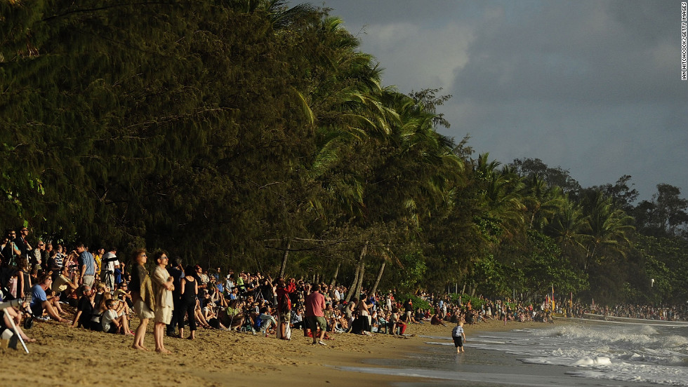 Spectators line the beach to view the total solar eclipse on Wednesday in Palm Cove.