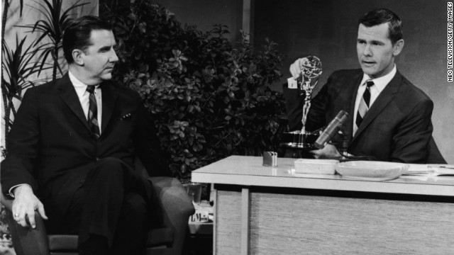 In 1963, Johnny Carson sits with an Emmy award on his desk beside announcer Ed McMahon.