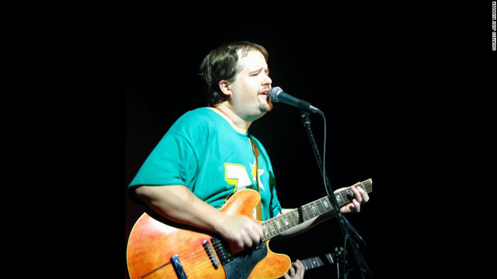 Steve Rummler playing guitar with his band, The Goonybirds, at a ski resort in 2002.