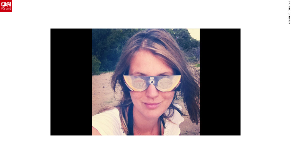 """Instagrammer <a href=""""http://statigr.am/viewer.php#/user/5591381/"""" target=""""_blank"""">Tawnymc</a> had style and concept covered with these chic glasses as she settled in to watch the eclipse from Buchanon Beach near Cairns. """"(They) were amazing, we could see the moon move across the sun and we shared them around the beach - they were just $10 too,"""" she says."""