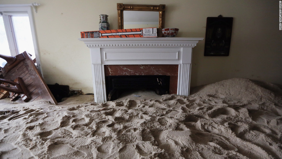 A living room is filled with sand Wednesday washed in by Superstorm Sandy in Point Pleasant Beach, New Jersey. Two weeks after the storm hit, many residents of the seaside town remain without power.