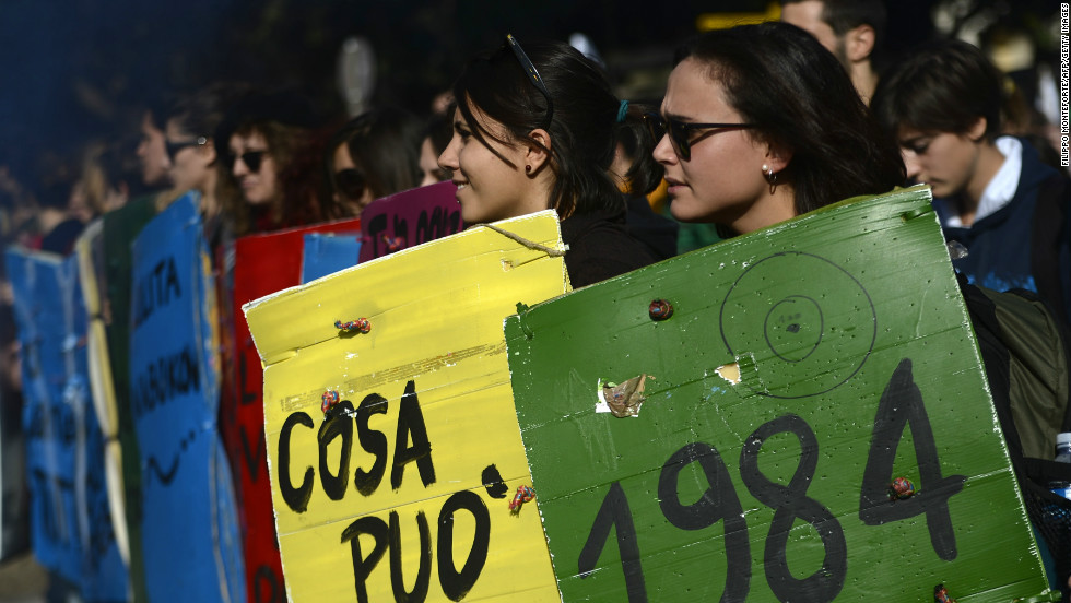 Student protesters hold placards with the titles of classic books Wednesday in Rome.