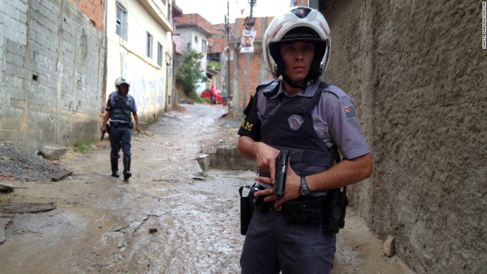 Military police patrol Brasilandia shantytown with their guns drawn. Nearly 100 police officers have been murdered in Sao Paulo so far this year, most of them ambushed off duty.