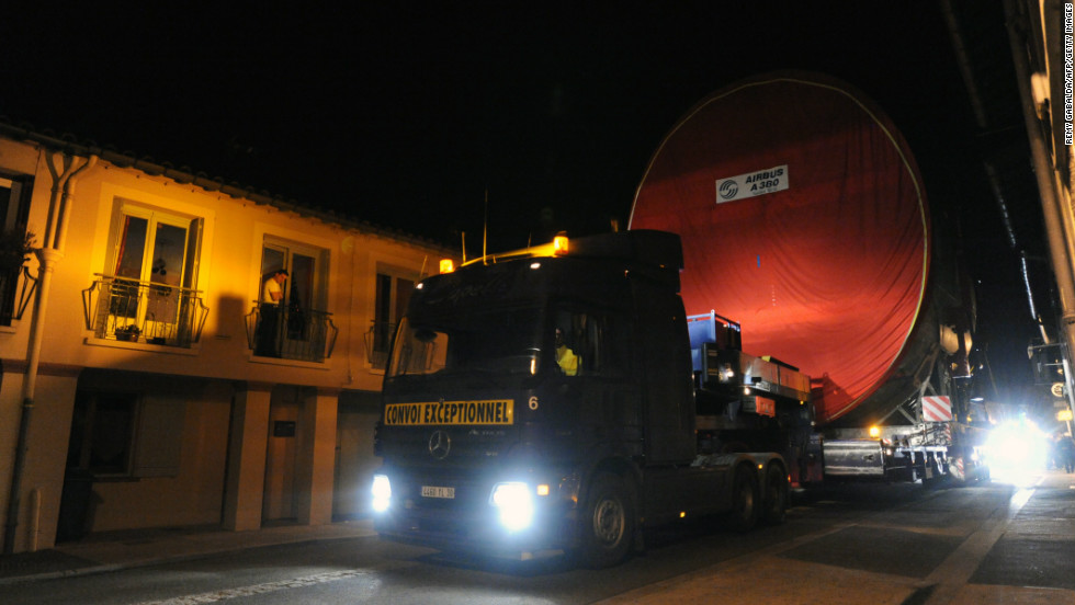 Every fortnight, the giant components of the Airbus A380 are hauled through the narrow streets of Levignac, southern France.