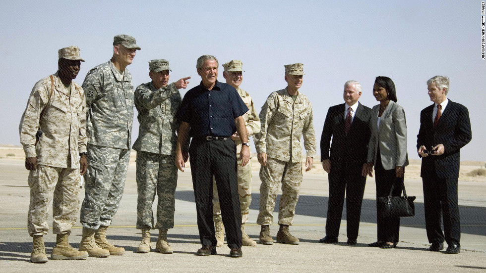 Petraeus, third from left, listens as President George W. Bush speaks at Al Asad Air Base in Anbar Province, Iraq, in September 2007. From the right, U.S. Ambassador to Iraq Ryan Croker, Secretary of State Condoleezza Rice and Defense Secretary Robert Gates, who arrived with Bush, look on.