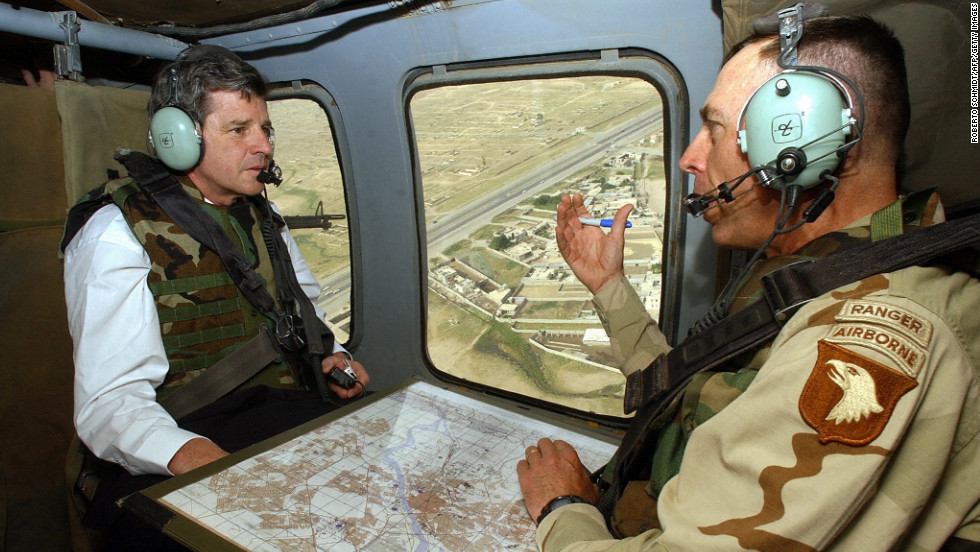 Petraeus served as commanding general of the 101st Airborne Division U.S. Army between 2002 and 2004 and led troops into battle  when the U.S. invaded Iraq in March 2003. Pictured, Petraeus speaks with  Paul Bremer, the new U.S. overseer in Iraq, during a helicopter tour of Mosul, Iraq, in May 2003.