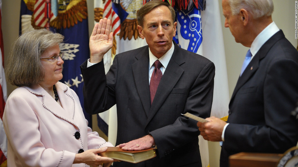 Petraeus takes the oath of office as the next director of the Central Intelligence Agency from Vice President Joe Biden as Petraeus' wife Holly looks on in September 2011 in the Roosevelt Room of the White House.