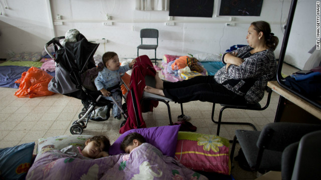 An Israeli woman and children sit inside a bomb shelter on November 14, 2012 in Netivot, Israel.