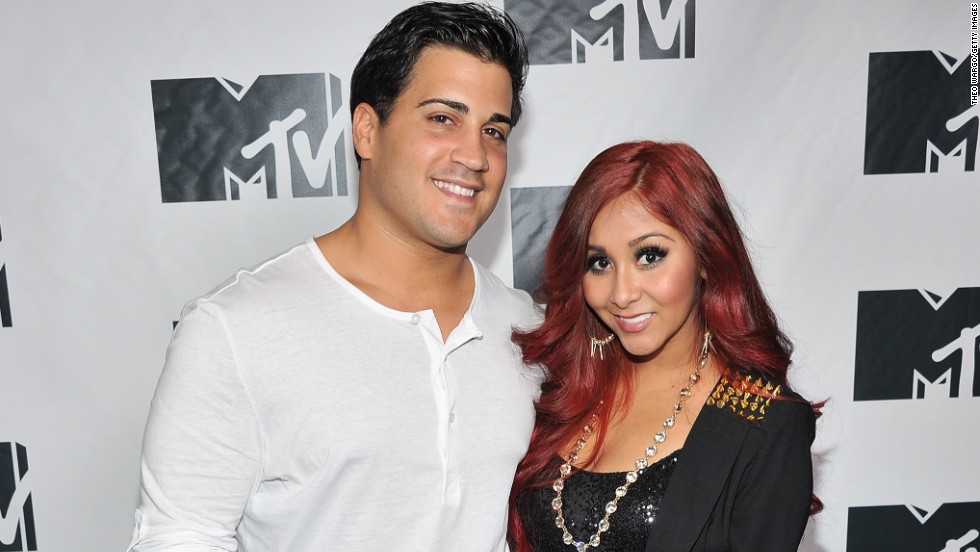 """Jersey Shore"" star Nicole 'Snooki' Polizzi and her fiance Jionni LaValle did their part to give back after Superstorm Sandy by attending MTV's ""Restore the Shore"" benefit on November 15."