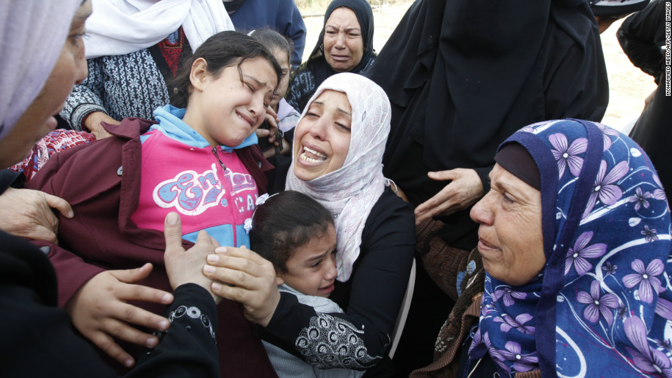 Palestinian women and children cry during the funeral of Audi Naser on Friday, November 16.