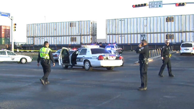 Train hits parade truck, killing 4