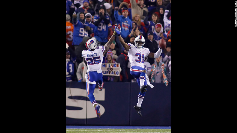 Jairus Byrd, right, and Da'Norris Searcy of the Buffalo Bills celebrate Byrd's fourth-quarter interception.