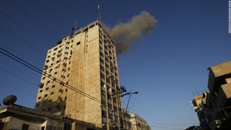 Smoke rises after an Israeli air strike on an office of Hamas television channel Al-Aqsa in the southern Gaza town of Rafah on Sunday, November 18. Israeli warplanes hit the Gaza City media center and homes in northern Gaza in the early morning.
