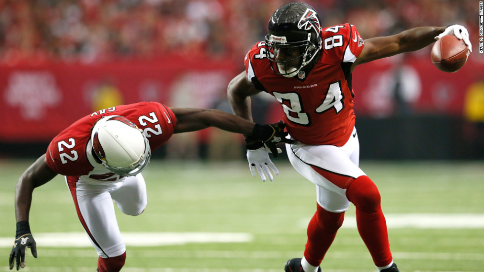 Roddy White of the Falcons breaks a tackle by William Gay of the Cardinals on Sunday.