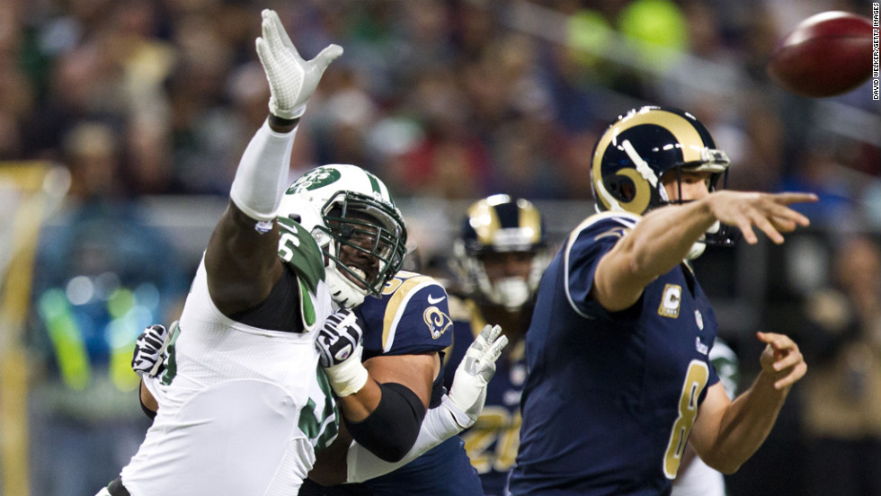 Defensive end Muhammad Wilkerson of the Jets tries to bat the ball away from quarterback Sam Bradford of the Rams during the game on Sunday.