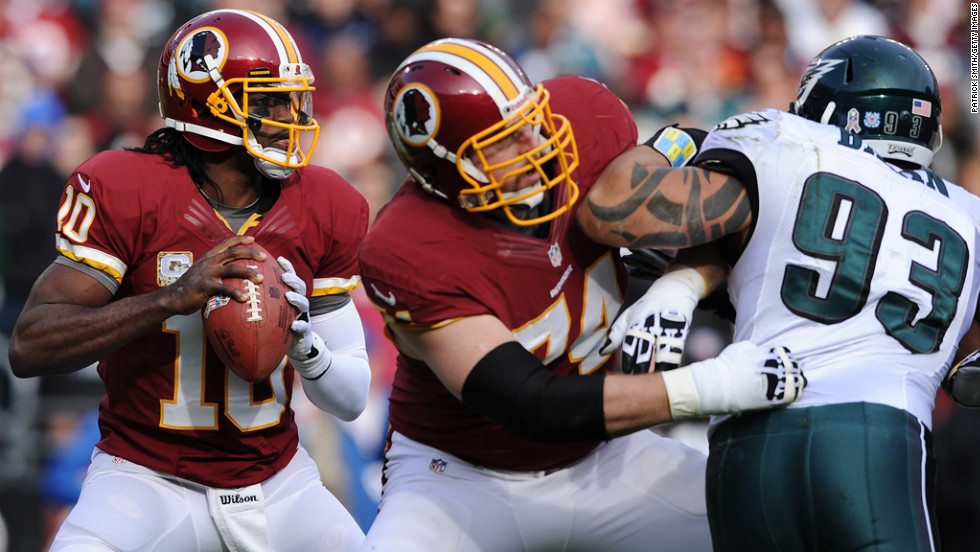 Quarterback Robert Griffin III of the Redskins looks to pass against the Eagles in the second quarter on Sunday.