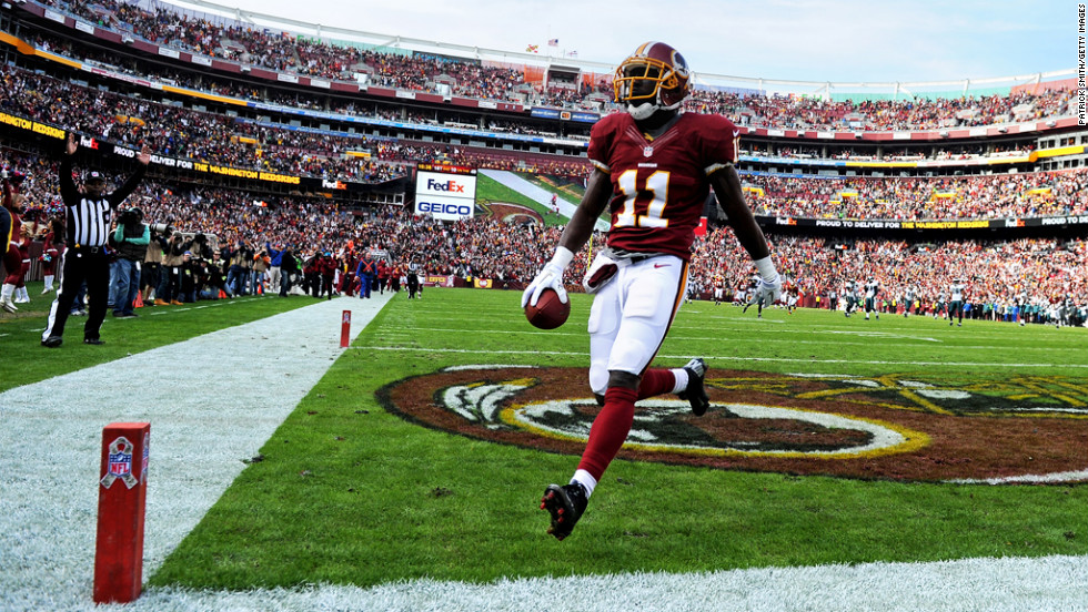 Wide receiver Aldrick Robinson of the Redskins runs through the end zone as he scores against the Eagles in the second quarter on Sunday.