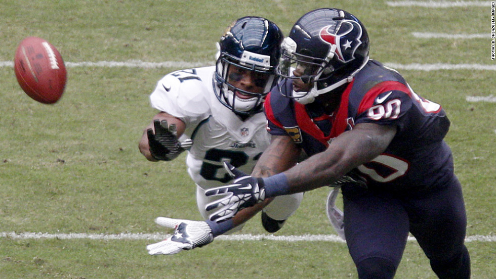 Andre Johnson of the Texans can't quite make the catch while Derek Cox of the Jaguars covers on the play on Sunday.