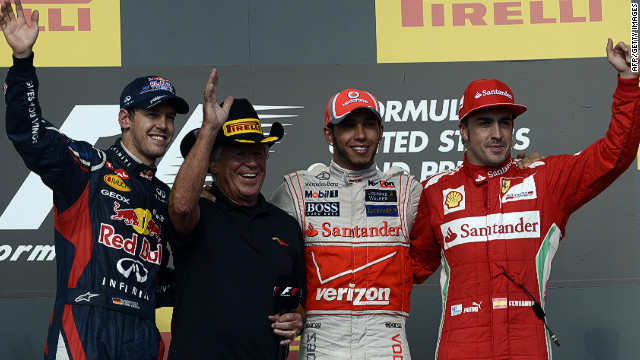 (L-R) Sebastian Vettel, former F1 champ Mario Andretti, Lewis Hamilton and Fernando Alonso on the podium in Texas