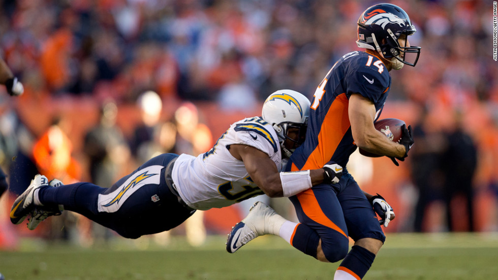 Cornerback Marcus Gilchrist of the Chargers makes a diving tackle after a reception by wide receiver Brandon Stokley of the Broncos on Sunday.
