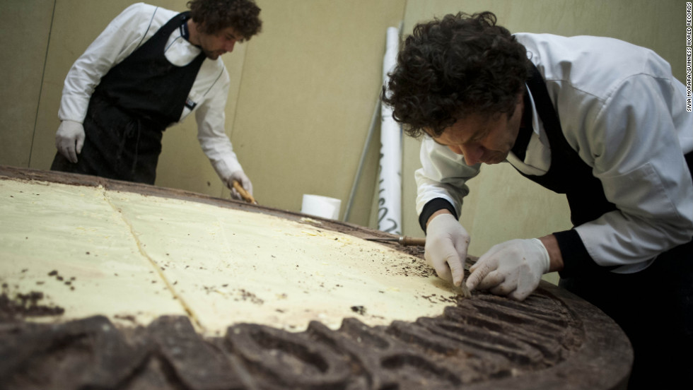 The largest chocolate coin in the world has been achieved by master chocolatiers in Bologna, Italy. The coin weighs 1,450 pounds and is 6 feet, 5 inches in diameter and 6.7 inches thick.