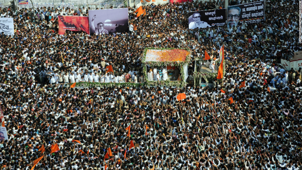 Thousands of Shiv Sena supporters from across the state take part in the funeral procession of Bal Thackeray in Mumbai, India, on Sunday.