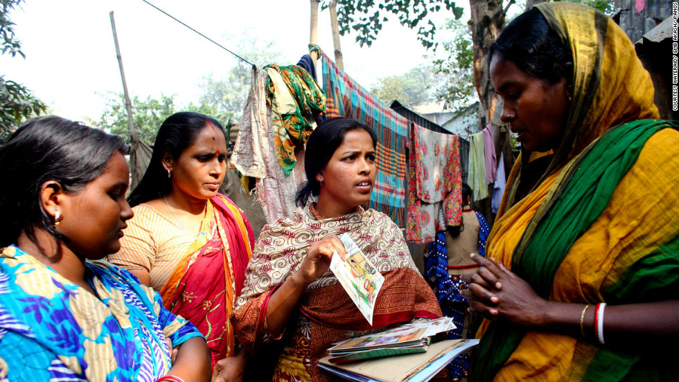 "Shamola Rani Mondol (center) in Dhaka, Bangladesh, is a local WASH committee member. All nine members of the committee are women who teach others in the community about hygiene. She says: ""The men respect us more now. Nowadays when we go anywhere the men give us seats with honor and they say that the women are able to do lots of things. Now the men are happy with the women's work."""
