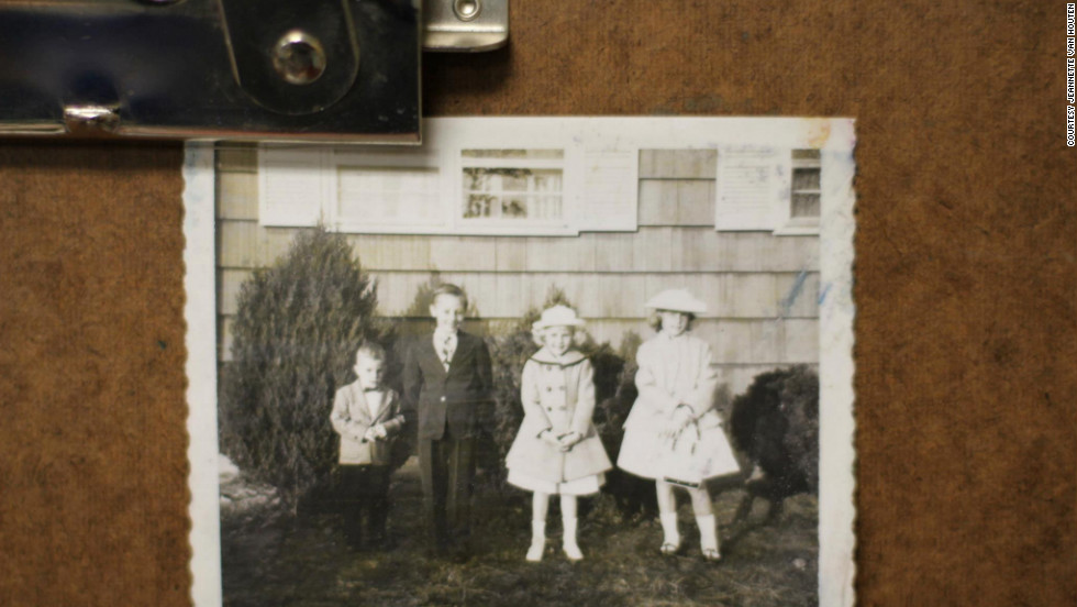 Dressed up children stand in front of a house in this photograph, featured on Jeannette Van Houten's Facebook page.