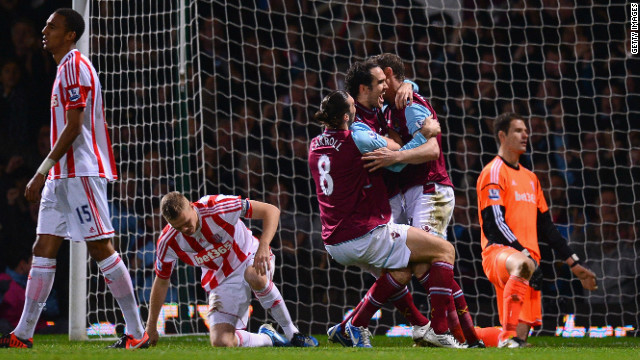 Joey O'Brien is sandwiched by Andy Carroll (8) and Kevin Nolan after scoring West Ham's equalizer against Stoke
