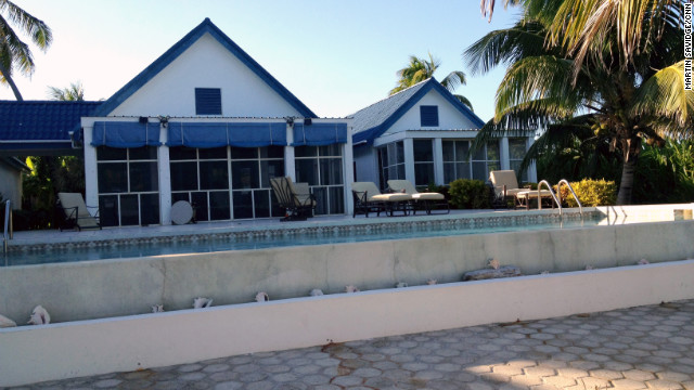 John McAfee shares his home in Belize with seven girlfriends, two women told CNN.