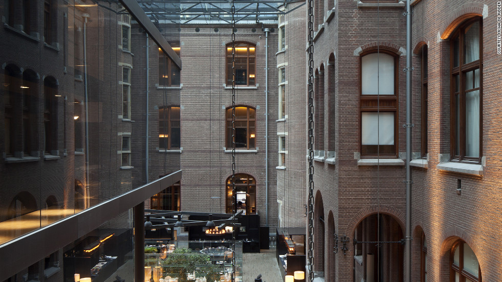 The vast enterance lobby of the Conservatorium hotel in Amsterdam. The building also features a library and indoor garden.