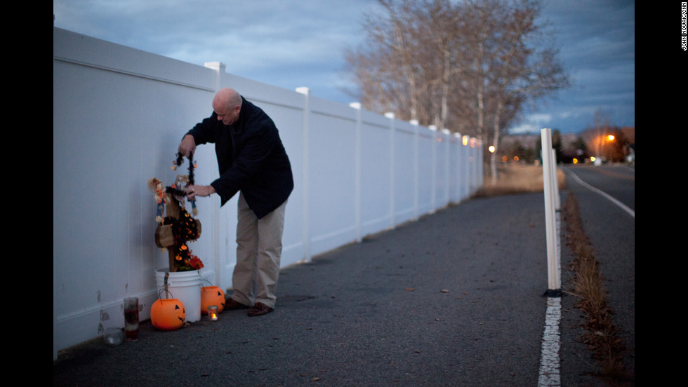 McCarthy adjusts holiday decorations at the memorial where his daughter Mariah was killed in Butte, Montana. Mariah and two of her friends were walking down a sidewalk in 2007 when a 20-year-old drunken driver hit them. Mariah, 14, was killed. Her two friends survived.