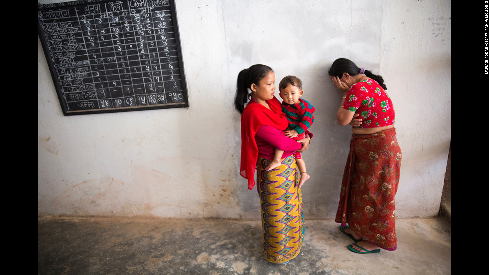A woman at a prison in the town of Nuwakot cries after sending her child away with Basnet. Basnet wants the children to maintain relationships with their parents, so she often takes them back to visit. Ultimately, the goal is to reunite the families outside prison.